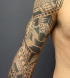 Best Samoan Sleeve Tattoo Model on arm by Lilzeu Tattoo designs