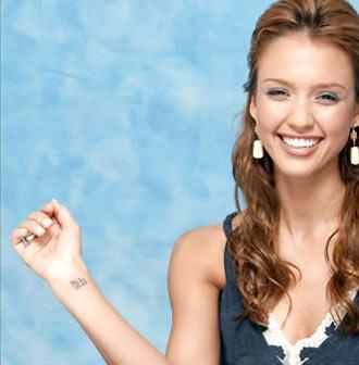 Jessica Alba Wrist Sanskrit Tattoos