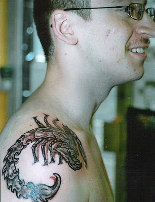Men Shoulder Scorpion Tattoo with Red Shades