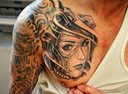 Shoulder Blade Face Tattoo Design