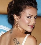 Alyssa Milano Back Shoulder Cross Tattoo Design - Celebrity Tattoo