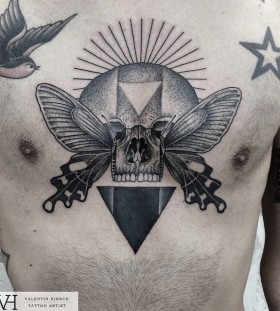 skull-and-wings-chest-tattoo-by-valentin-hirsch
