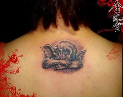 Upper Back Skull Tattoos For Girls