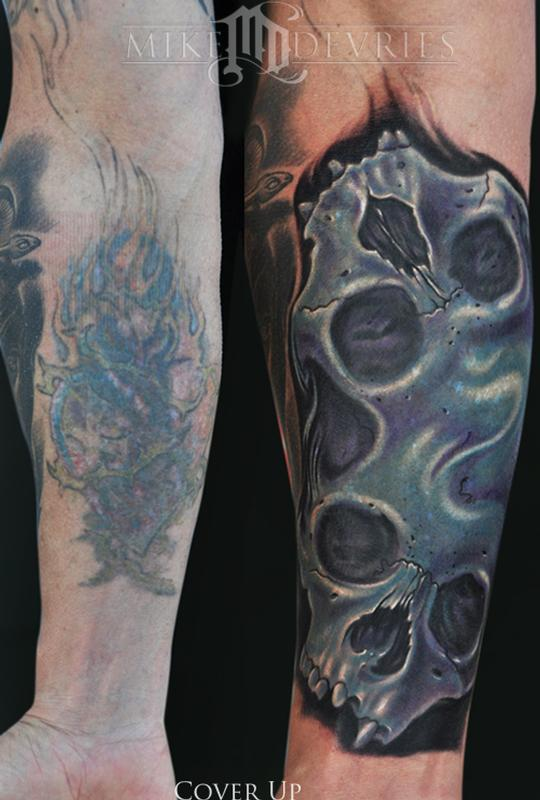 Awesome Completed Covering Work with Skull Tattoos