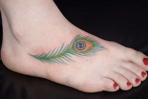 Sexy Foot With Simple Feather Peacock Tattoo