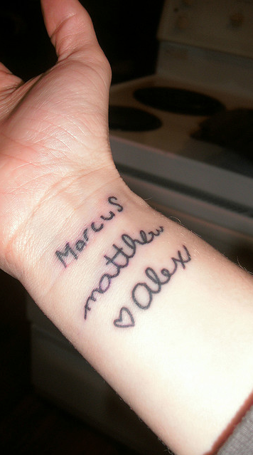 Tattoo with People Name on Wrist