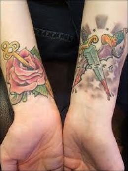 Colored Rose and Cross Stiletto Tattoo Design on Wrist