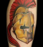 Bronze Spartan Helmet Tattoo On Arm