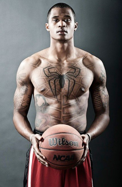 Darren Moores Spiderman Logo On Chest Tattoo