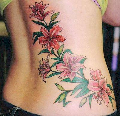 Pink Lilies Tattoo On Side Body Of Girl