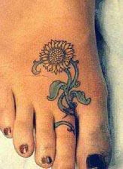 Cute Tiny Sunflower Tattoo Design on Foot