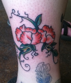 Couple Sweet Pea Flowers And Vines Tattoo Meaning