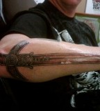 Tribal Dragon Sword Tattoo Design Inspiration