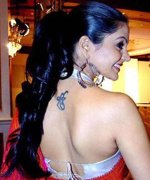 Mandira Bedi Small Tattoo on Back