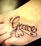 Grace's Name in Swirly Tattoo Design on Leg