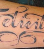 Felicity Name in Swirly Design Tattoo on Outer Lower Hand