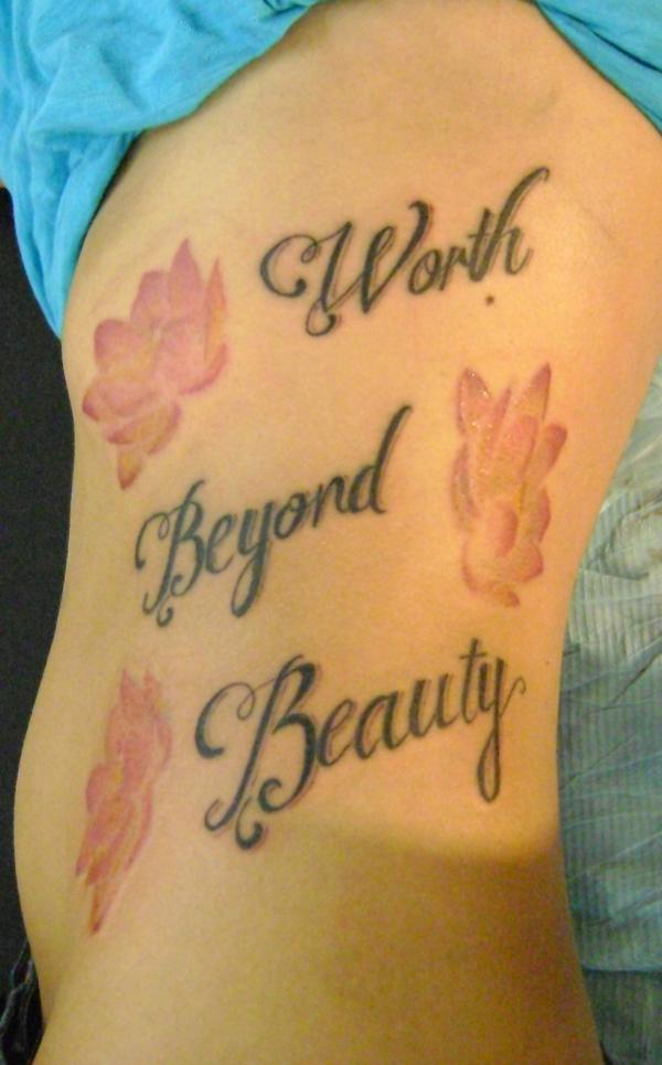Lettering and Flower Tattoo on Side for Women