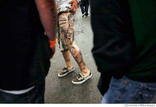 Man with Left Leg Tattoo artist at Ink Slinger Tattoo