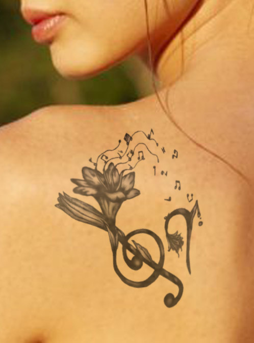 Music Note Tattoos On Woman Shoulder