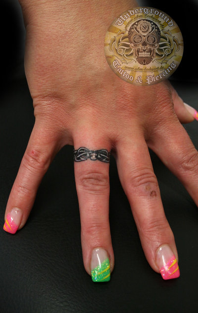 Beautiful Ring Finger Tattoo Design Picture