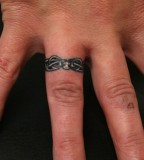 Marvelous Tattoo Design on Ring Finger