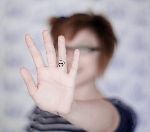 Grand Skull Shaped Tattoo Design on Ring Finger