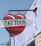 Closeup View Of Euphoria Tattoo Shop Sign