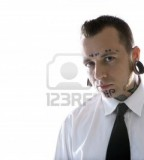 Caucasian Midadult Man With Tattoos And Piercings Wearing Necktie