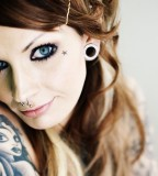 Blonde Girl With Tattoos And Piercings Image