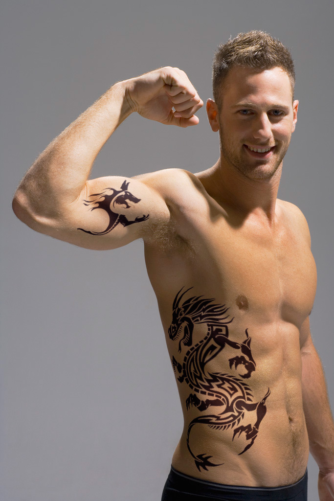 Dragon on Hip and Tribal on Bicep Tattoo Designs For Men