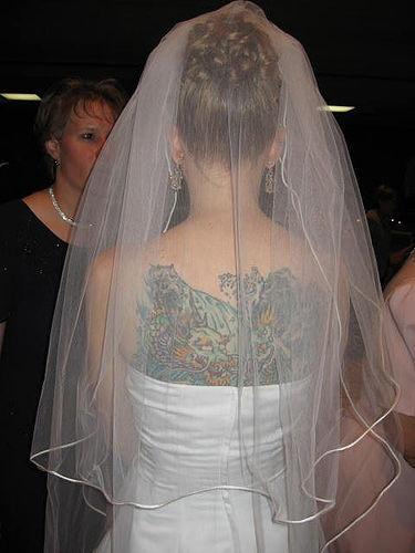 Gorgeous Women Back Tattoo in Wedding Ceremony