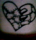 Broken Heart On Inner Ankel Tattoo