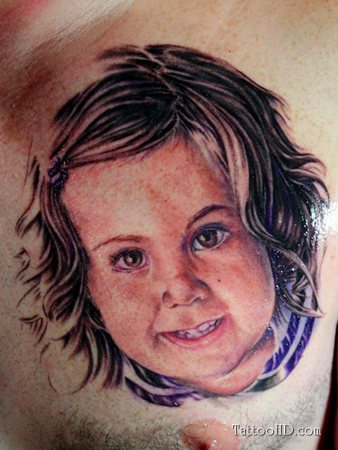 Cute Baby Face Chest Tattoo Designs