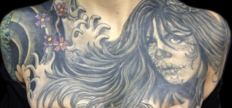 Contemporary Tattoo Design on Chest of Ms. Millz Marley