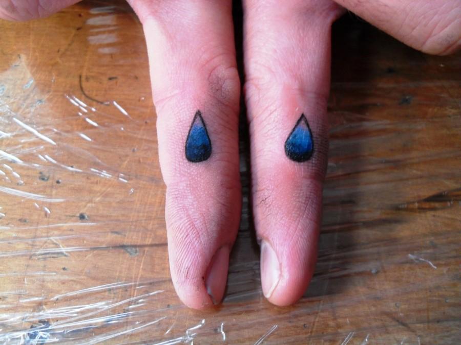 Tear Drop Tattoo on Fingers