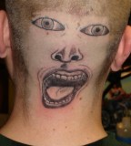 Bold, Dumb, and Funny Guy Face Tattoo on Head