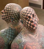 Bold Crazy Full Face, Head, and Body Tattoo
