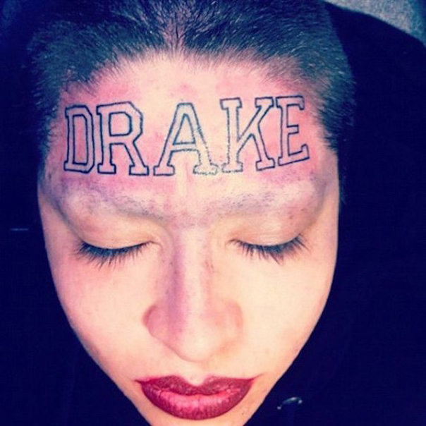 Bold Lettering Name Tattoo on Women Forehead