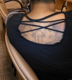 Bold yet Funny Adult Stuff Tattoo on Women Back (NSFW)