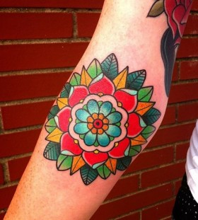 traditional flower tattoo on arm