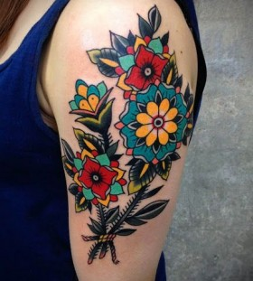 traditional style arm flower tattoo