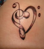 Bass Clef And Treble Clef Tattoo - Upper Back Tattoos