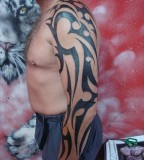 Men with Large Tribal Arm-Sleve Tattoo Design