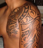 Half-Sleeve to Chest Tribal Tattoo Design for Men