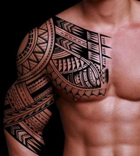 tribal chest and arm tattoos for men