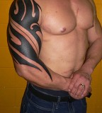 Half-Sleeve Tribal Tattoo Design for Amazing Look Muscle Men