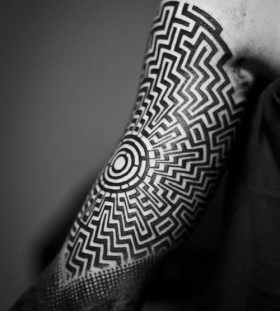 upper arm labyrinth tattoos for men
