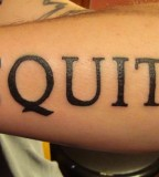 Aequitas Part of Veritas Aequitas Lettering Tattoo on Outer Lower Arm