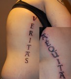 Veritas Aequitas Tattoos on Both Ribs Area, Tattoo Idea for Women (NSFW)