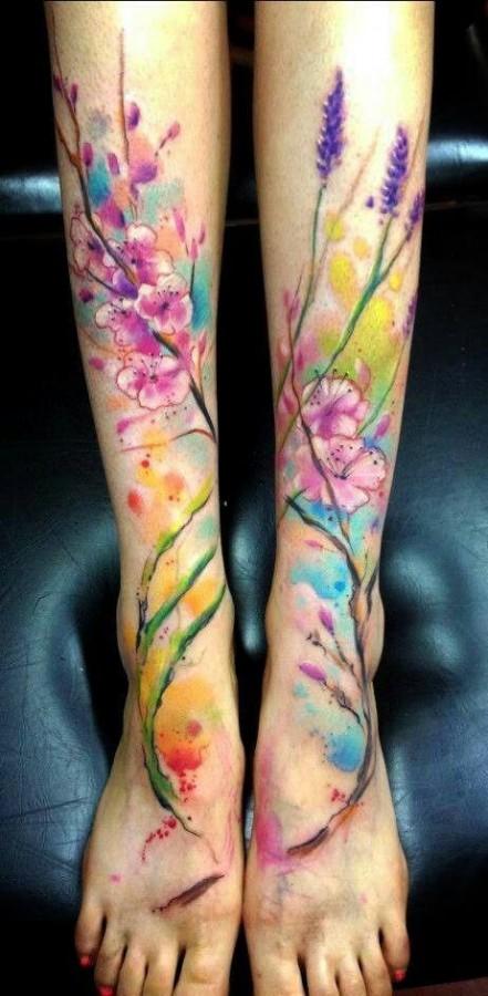 watercolor effect wildflower tattoo on lower leg